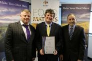 photo showing Mr Cretney MLC (centre), Member of DEFA, presenting the BRC AA certification to Allan Skillicorn, Chairman of Isle of Man Meats (right) and Mike Owen, Chief Executive.